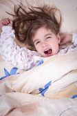 Sweet happy little girl sleeping — Stock Photo