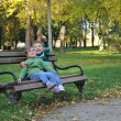 Kids playing in autumn park — Foto de stock #17377653
