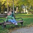 Foto Stock: Kids playing in autumn park