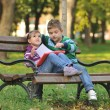 Kids playing in autumn park — Stock Photo #17377673