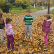 Stock Photo: Kids playing in autumn park