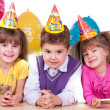 Kids celebrating birthday party — Stock fotografie