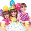 Foto Stock: Kids celebrating birthday party