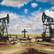 Oil pump jack — Stock Photo #18555725