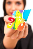 A Happy Woman holding a credit card — Stock Photo