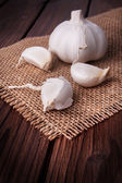Garlic on a wooden table — Stock Photo