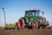 Tractor in the field sow — Stock Photo