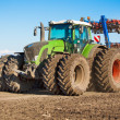 Stock Photo: Tractor in field sow