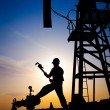 Oil worker silhouette — Stock Photo