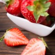 Strawberries on wooden plate — Foto Stock