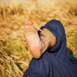Man lying in wheat field — Stock Photo
