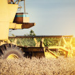 Combine harvester working a wheat field — Stock Photo #27947955