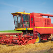 Combine harvester working a wheat field — Stock Photo