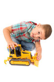 Little boy plays with toy tractor — Stock Photo