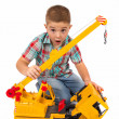 Little boy plays with toy truck — Stock Photo