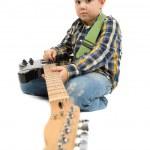 Young guitarist playing guitar — Stock Photo #37500455