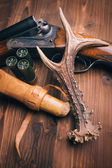 Shotgun on wooden background — Stock Photo