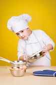 Little boy chef in uniform — Stock Photo