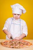 Boy making pizza — Stock Photo