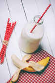 Fresh milk and glass on wooden table — Stock Photo