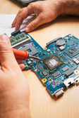 Tech tests electronic equipment in service — Stock Photo