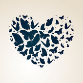Vector heart made of butterflies — Stock Vector