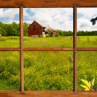 Country landscape seen through the farm house window. — Stock Photo #25316921