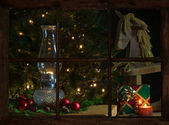Cozy Christmas scene, as viewed through the farmhouse window. — Stock Photo