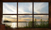 Summer sunset seen through the cottage window. — Stock Photo