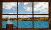Autumn lake view through window. — Stock Photo