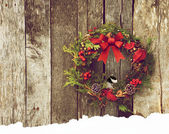 Christmas wreath with chickadee. — Stock Photo
