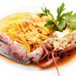 Tagliolini with lobster - Stock Photo