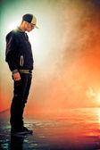 Teenage brakedancer boy standing in a smoke — Stock Photo