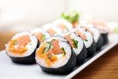 Salmon and caviar rolls — Stock Photo