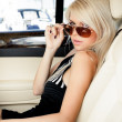Stock Photo: Lady in a luxury car
