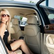 Lady in a luxury car — Stock Photo