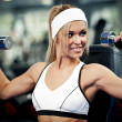 Pumping up biceps — Stock Photo