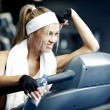 Fitness on a treadmill — Stock Photo