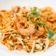 Pasta with salmon and shrimps — Stock Photo