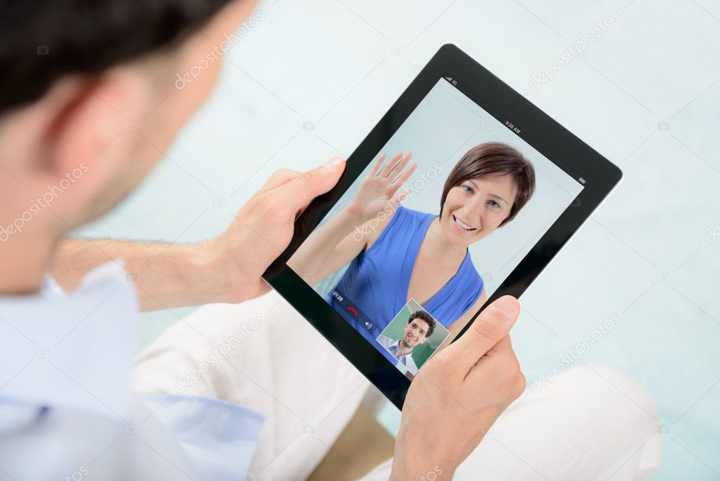 A young couple talking to each other via online video chat. — Stock Photo #12391490