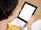 Holding digital tablet with blank screen — Stock Photo