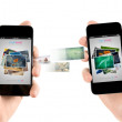 Mobile smart phones while transferring pictures — Stock Photo