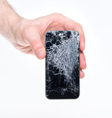 Hand holding broken Apple iPhone 4 — Stock Photo