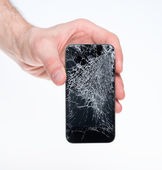 Man holding broken smartphone — Stock Photo