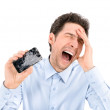 Angry man showing broken smartphone — Stock Photo