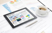 Business news website on digital tablet — Stock Photo