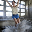 Woman jumping in dust — Stock Photo #12588039