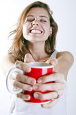 Smiling with a coffee — Stock Photo