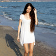 Beautiful girl in a white dress on the beach. — Stock Photo