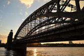 Neva river and Bridge Peter the Great at sunset — Stock Photo